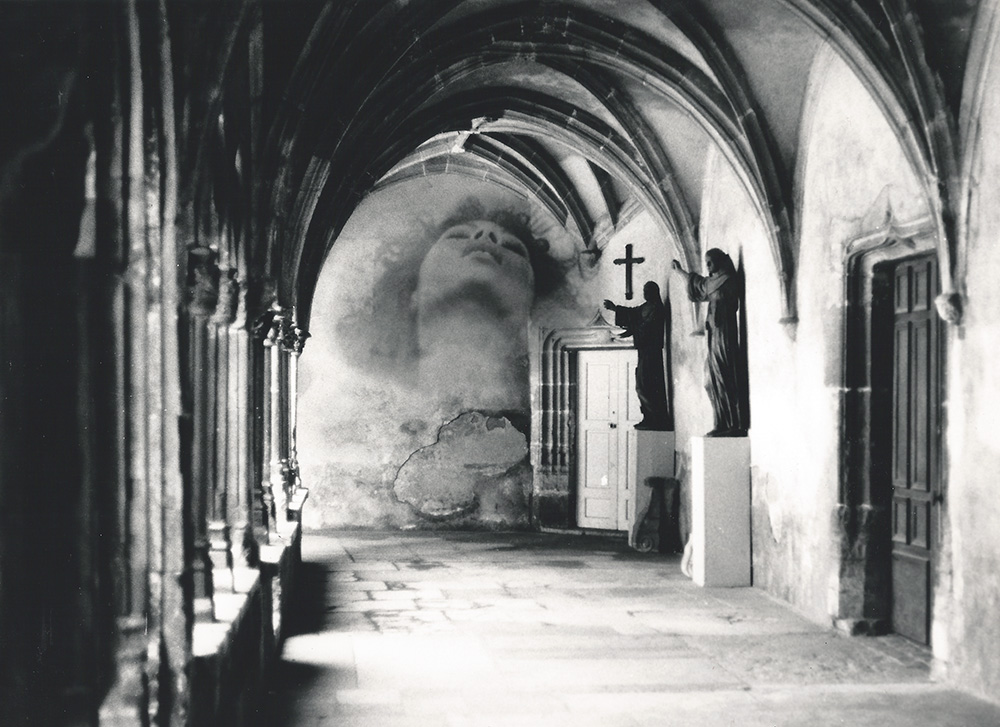 darkroom experiment 1991. photograph of a hallway in a monastery in france. blended with a photograph of the tv-screen of some woman having an orgasm